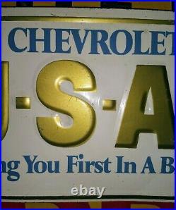 Chevrolet USA-1 VINTAGE embossed metal vanity license plate. NICE! Little Warped