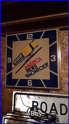 Vintage 1970s 1980s 36 square America Rides Monroe shocks clock